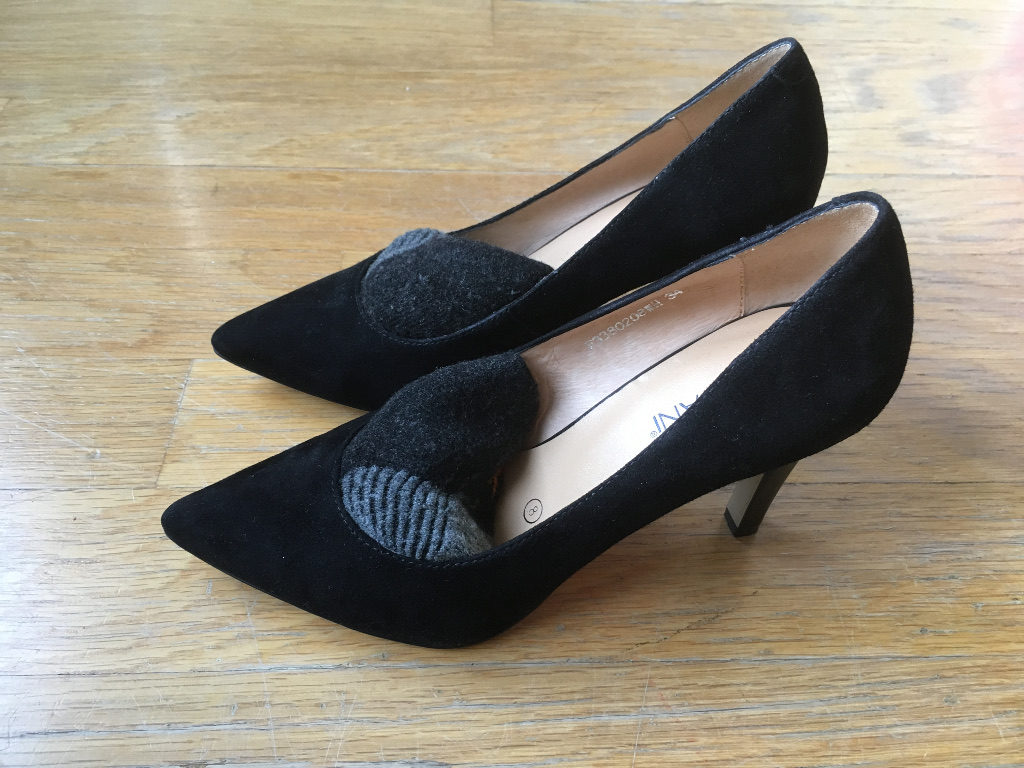 rolled socks inside heel shoes to stretch stock